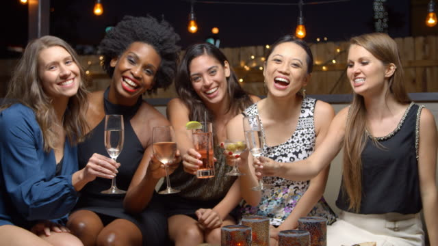 female friends enjoying night out at rooftop bar, slow motion - bachelorette party stock videos and b-roll footage