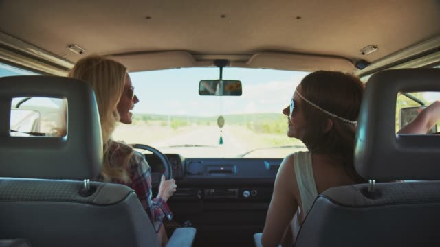 female friends enjoying road trip during summer - road trip стоковые видео и кадры b-roll