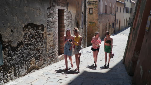 female friends exploring volterra - bachelorette party stock videos & royalty-free footage