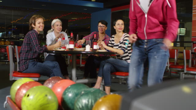Female Friends Having Fun at Bowling Alley