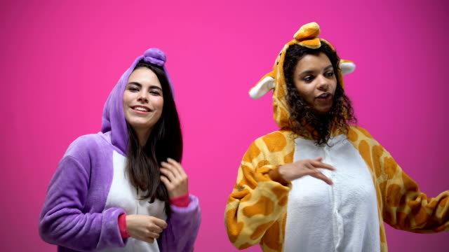 female friends in unicorn and giraffe pajamas dancing, carnival party, fun time - pajamas stock videos & royalty-free footage