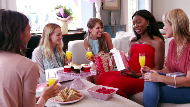 female friends meeting for baby shower shot on r3d - baby shower stock videos and b-roll footage