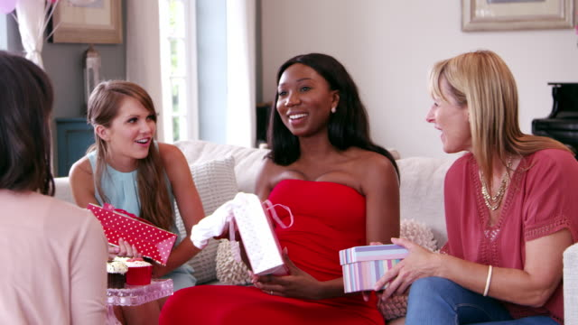 Female Friends Meeting For Baby Shower Shot On R3D video