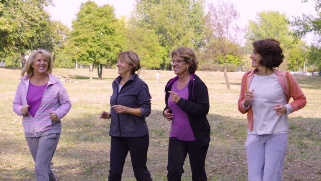 Female Friends over fifty exercising outdoors video