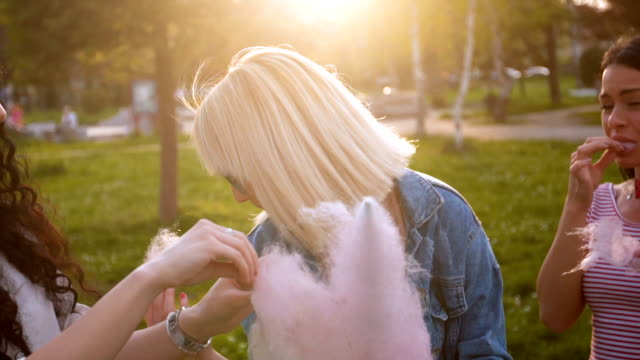 Female friends sharing cotton candy video