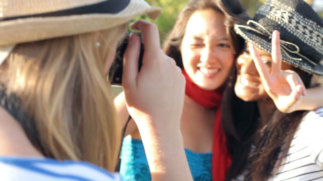 Female Friends Taking Photographs Of Each Other In Park video