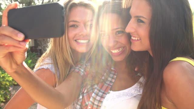 Female Friends Taking Selfie On Mobile Phone In Slow Motion video