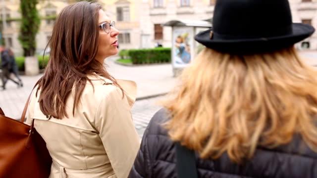 Female friends walking city video