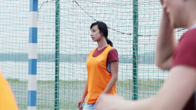 Female goalkeeper is nervous about match on post Female goalkeeper standing on her post, waiting for ball and watching game goal post stock videos & royalty-free footage