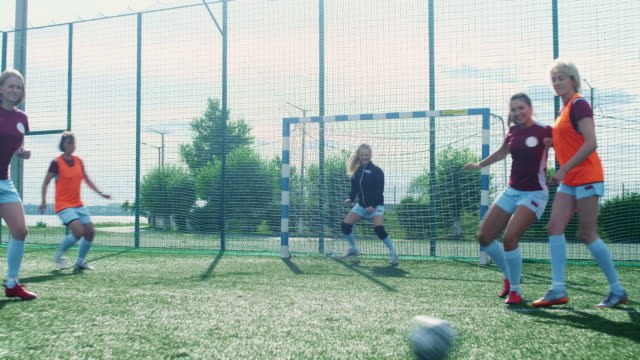 Female goalkeeper missing goal Female soccer teams playing match outdoor and shooting goal goal post stock videos & royalty-free footage