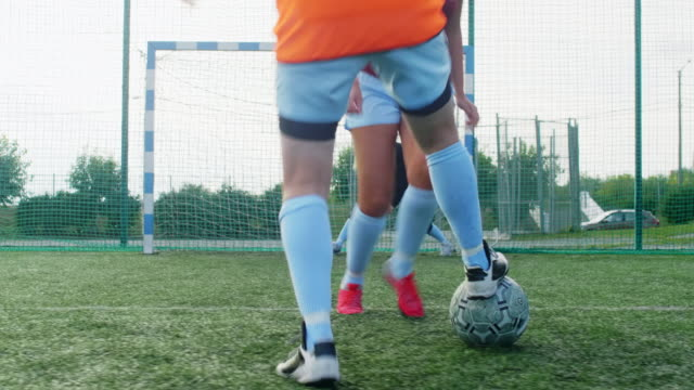 Female goalkeeper on her post during soccer match Young professional goalkeeper waiting for ball on her post, while forwards fighting for it in foreground goal post stock videos & royalty-free footage