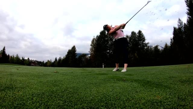 Female golfer making the drive
