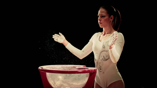 SLO MO Female gymnast clapping her chalky hands video