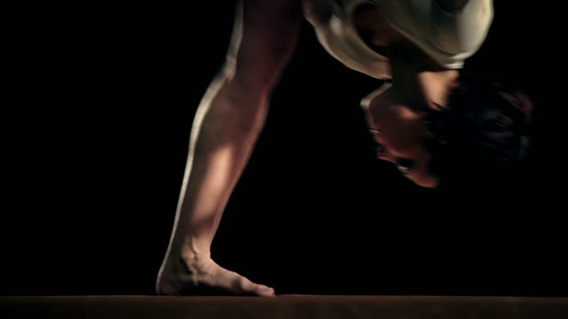 SLO MO Female gymnast doing a balance beam flip video