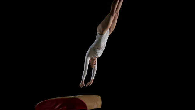 SLO MO DS Female gymnast performing a back handspring on the vault video