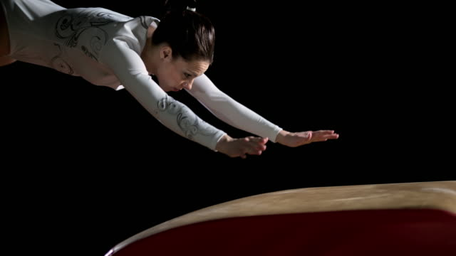 SLO MO DS Female gymnast performing a front handspring on a vault video