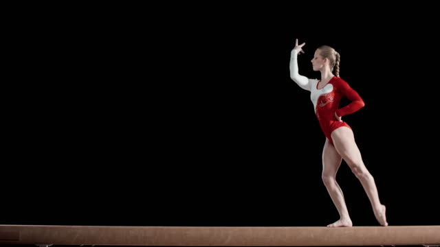 Female gymnast performing her routine on a balance beam video