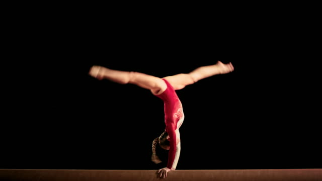 LD Female gymnast performing her routine on the balance beam video