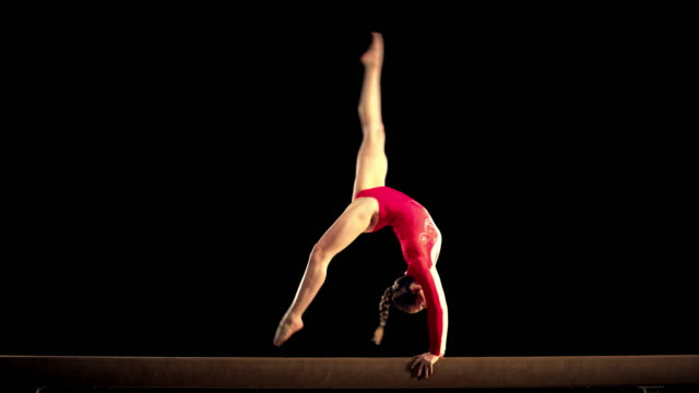 SLO MO Female gymnast performing on the balance beam video