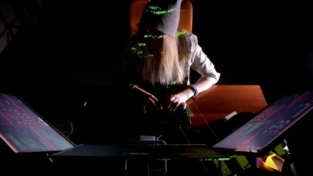 female hacker working on a computer, coding at night - anonymous hackers stock videos and b-roll footage
