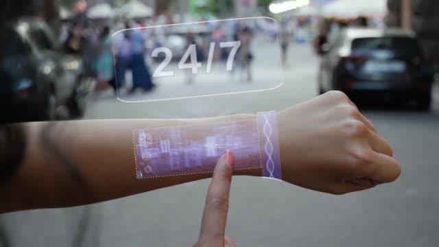 Female hand activates hologram 24 7