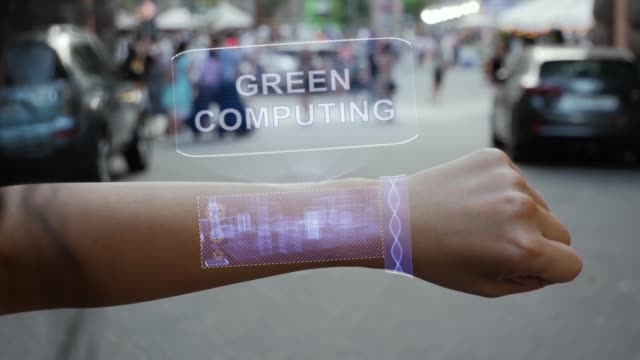 Female hand activates hologram Green computing