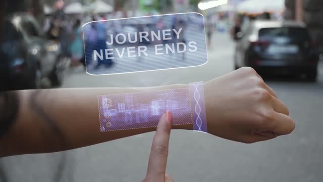 Female hand activates hologram Journey never ends