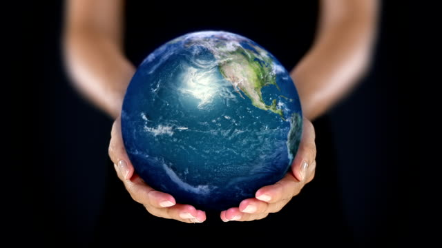 Female hand holding a realistic Earth. Starting in North America. video