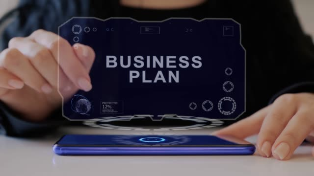 Female hand interacts hologram Business plan