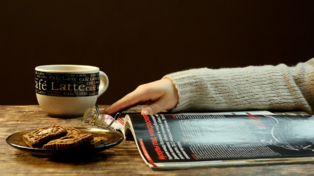Female hand leafing a magazine video