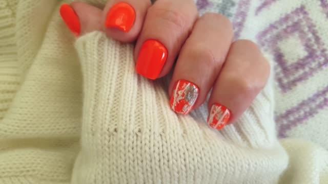female hand manicure sweater - lungo video stock e b–roll