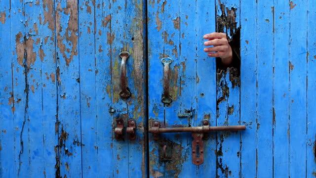 Female hand opening wooden door video