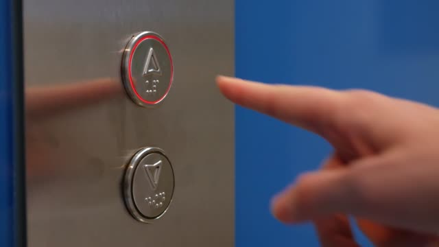 Female Hand Pushing Elevator Button in Office Center or Hotel. Young Woman Pressing Lift Button Up. The finger presses the button with the arrow pointed up. Closeup. 4K Female Hand Pushing Elevator Button in Office Center or Hotel. Young Woman Pressing Lift Button Up. The finger presses the button with the arrow pointed up. Closeup push button stock videos & royalty-free footage