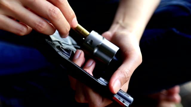 Female Hand Reloading Ammunition, Revolvers Female Hand Reloading Ammunition, Revolvers HD gun stock videos & royalty-free footage