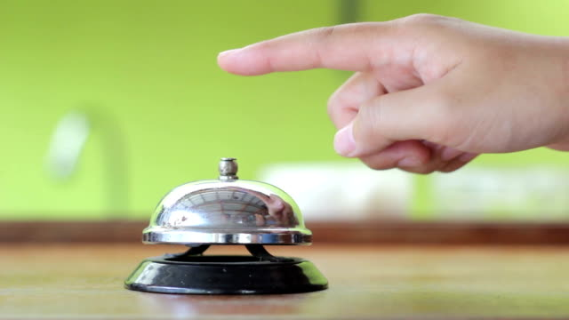 female hand ringing silver service bell,Close-up video