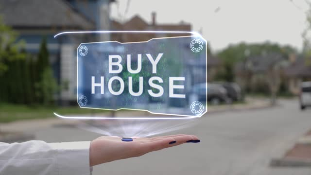 Female hand showing hologram Buy house