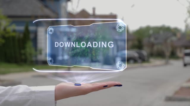 Female hand showing hologram Downloading