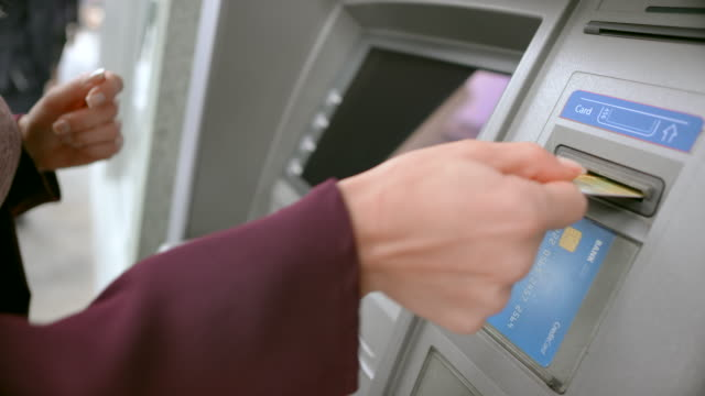ld female hand taking bank card and the money out of the atm machine and walking away - banks and atms stock videos & royalty-free footage