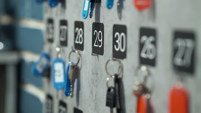 Female hand taking locker key at reception video