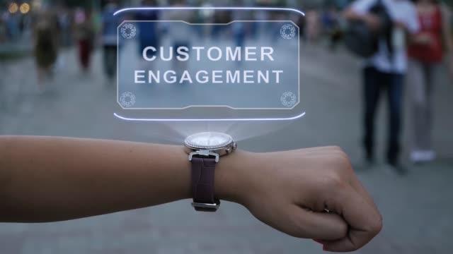 Female hand with hologram Customer engagement