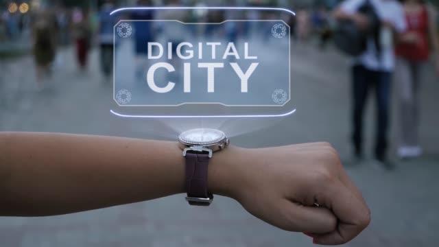 Female hand with hologram Digital city