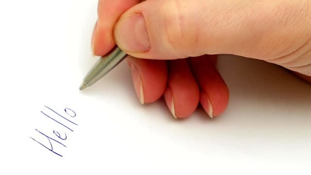 Female hand writes My dear friend on the paper video