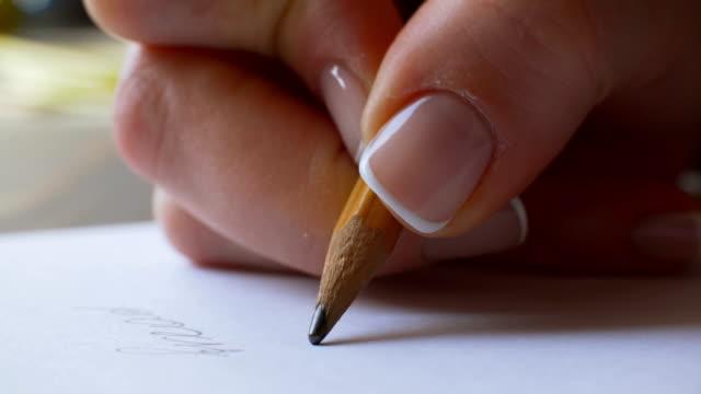 female hand writing on paper - служащая стоковые видео и кадры b-roll