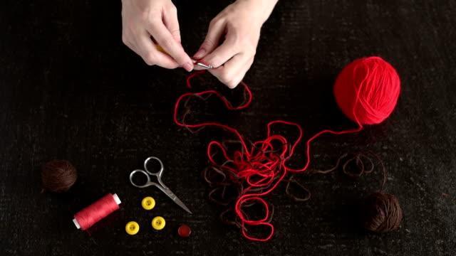 Female hands begin crocheting video