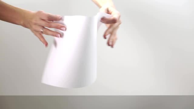 Female hands crumpling a sheet of paper video