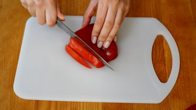 Female hands cutting red pepper video