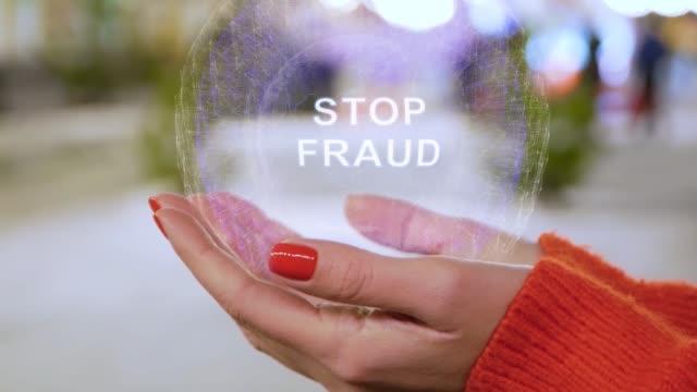 stockvideo's en b-roll-footage met vrouwelijke handen holding hologram met tekst stop fraude - kids online abuse