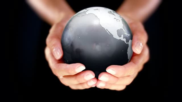 Female hands holding the Earth. Starting in US. gray. video