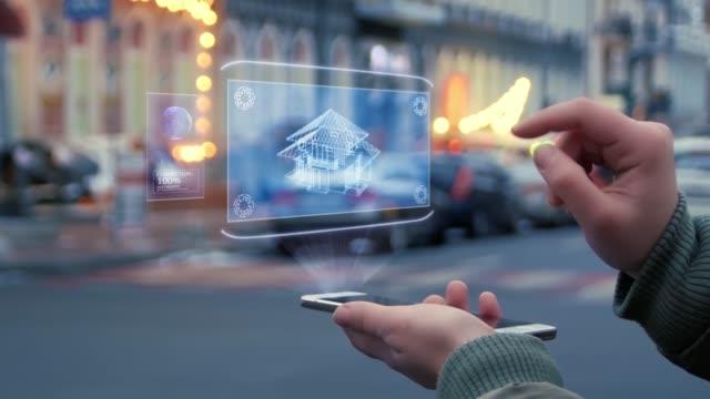 weibliche hände interagieren hud hologramm haus - hypothek stock-videos und b-roll-filmmaterial
