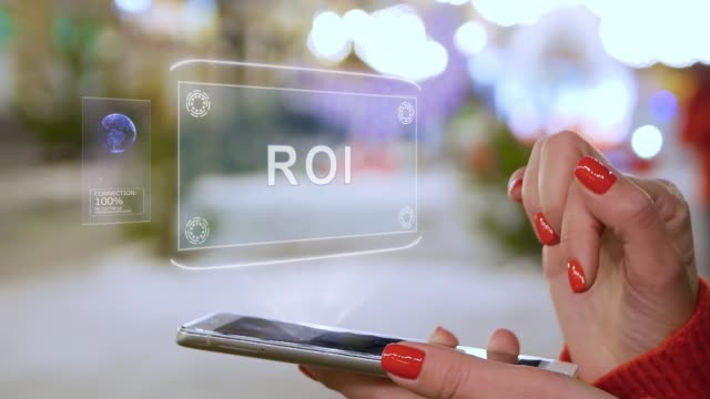 Female hands interact HUD hologram ROI